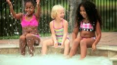Diverse happy children enjoying sunshine in swimming pool  Stock Footage