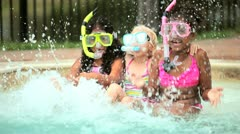 Girls on vacation using snorkel in swimming pool  Stock Footage