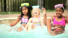 Happy multi ethnic children health exercising in outdoor pool  Stock Footage