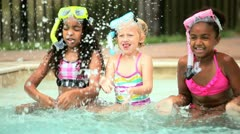Diverse girls splashing each other in outdoor pool  Stock Footage