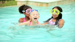 Multi ethnic lucky girls have fun on holiday in outdoor pool  Stock Footage