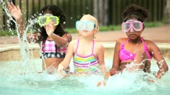 Diverse pre schoolgirls have fun in swimming pool   Stock Footage