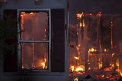 Night house arson fire window destroyed - stock photo