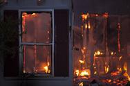 Stock Photo of Night house arson fire window destroyed