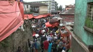 Stock Video Footage of African crowded market road view from above steps