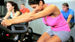 Exercising on Modern Gym Equipment Stock Footage