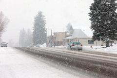 Snow blizzard small town road Stock Photos