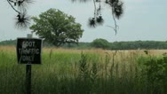 A peaceful prarie field with foot traffic sign Stock Footage