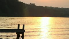Sunset, Dock and Personal Watercraft (Jet Ski or Waverunner) Stock Footage