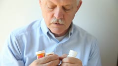 Confused senior with meds Stock Footage