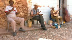 Street musicians on streets of Trinidad, Cuba Stock Footage