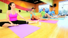 Multi ethnic health fitness group working out in body toning classes Stock Footage