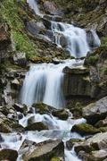 Alaska waterfall Skagway mountains vibrant bold Stock Photos