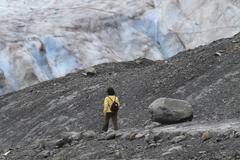 Exit Glacier woman hikes trail Alaska Stock Photos