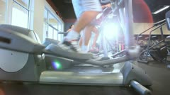 Exercising on Cross Trainers Stock Footage