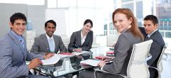 business group showing ethnic diversity smiling at the camera - stock photo