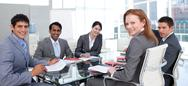 Stock Photo of business group showing ethnic diversity smiling at the camera