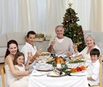 Stock Photo of family tusting with white wine in a christmas dinner