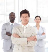 self-assured young manager with his team - stock photo