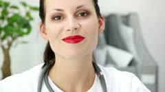 Female doctor talking to you in office Stock Footage