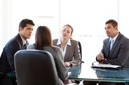 Stock Photo of rear view of a businesswoman being interviewed by three executives