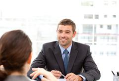Stock Photo of two business people talking together during a meeting