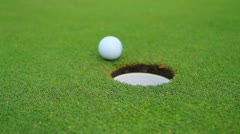 Golf Ball Rolls Into Hole - Green Stock Footage