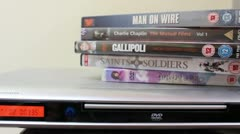 Dolly shot of dvd and player Stock Footage