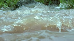 Super Slow Motion bubbling rolling waves of water in a stream Stock Footage
