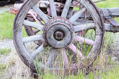 Antique historic wooden wagon wheel Stock Photos