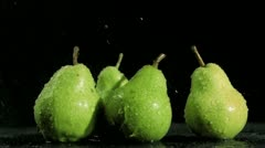 Tasty pears in super slow motion being soaked Stock Footage