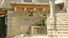 Old fountain in a traditional village Stock Footage