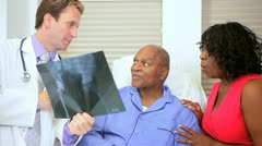 Elderly Male Patient Seeing X-Ray Results - stock footage