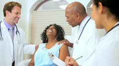 Hospital Consultant Treating Senior Patient Stock Footage
