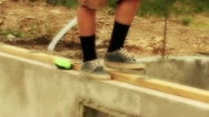 Man walks on foundation at construction site Stock Footage