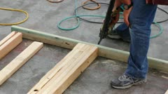 Framing house with nail gun Stock Footage