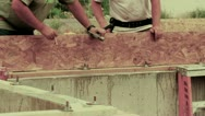 Construction workers placing boards on foundation Stock Footage
