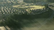 Stock Video Footage of Early Morning Fog over Suburban Neighborhood on Hillside - Aerial