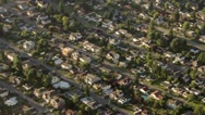 Stock Video Footage of Long Suburban Street Rows in Residential Neighborhood - Aerial