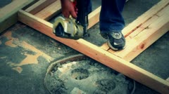 Constructing a wall with nail gun Stock Footage