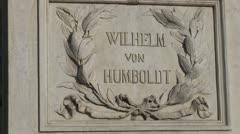 Wilhelm von Humboldt statue in front of Humboldt University in Berlin Stock Footage