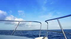 Boating in blue ocean sea view from boat bow deck Stock Footage