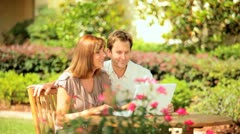 Caucasian Couple Using Computer Garden - stock footage
