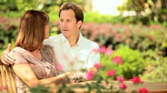 Stock Video Footage of Contented Couple Sitting Home Garden