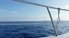 Boat sailing in blue mediterranean sea on ibiza islands Stock Footage