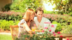 Couple with Laptop Garden Table Stock Footage