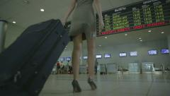 woman with a suitcase at the airport 2 - stock footage