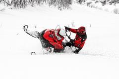 Man riding winter snowmobile hard turn art Stock Photos