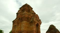 Tilt down from roof of Thap Poshanu Cham Tower Ancient temple Stock Footage