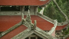Detailed views of carvings on Vietnam Takou Linh Son Truong Tho pagoda Stock Footage
